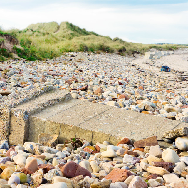 """Fallen sea defence"" stock image"