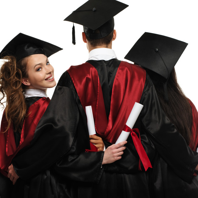 """""""Group of graduated young students with blank notice board"""" stock image"""