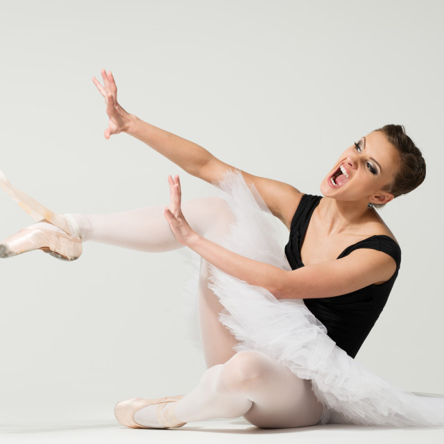 """""""Young angry fed up ballerina dancer sitting on a floor"""" stock image"""