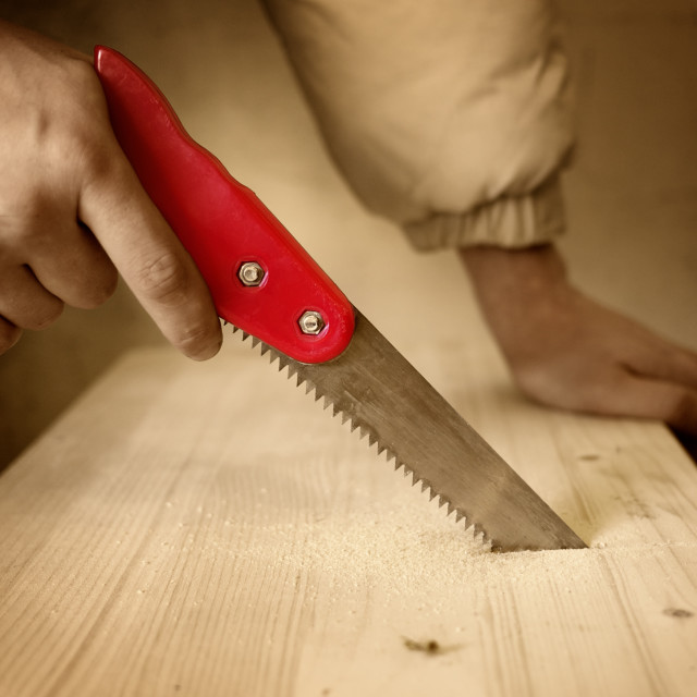 """""""Close-up work cutting wood furniture by hand saw"""" stock image"""