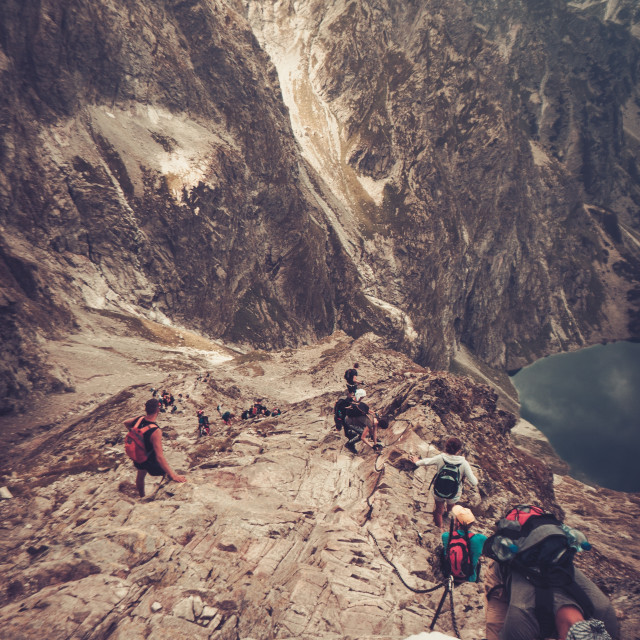 """""""Hikers climbing on a summit"""" stock image"""