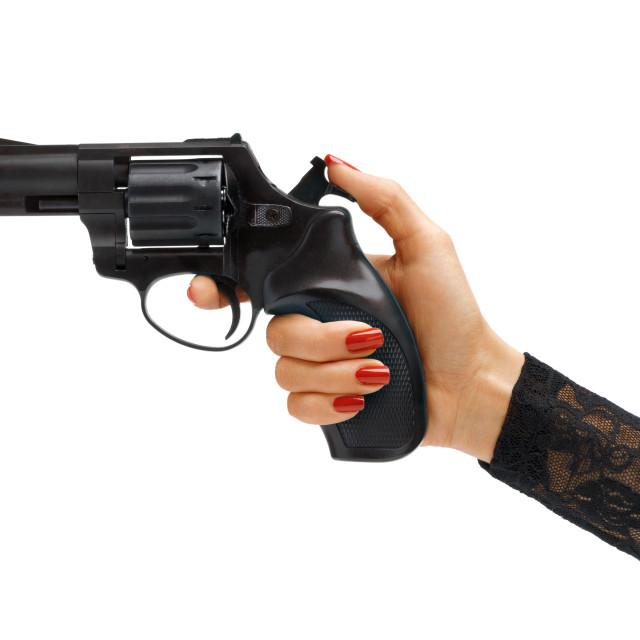 """Woman's hand cocking revolver gun."" stock image"
