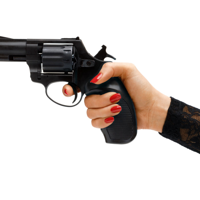 """""""Revolver in woman's hand."""" stock image"""