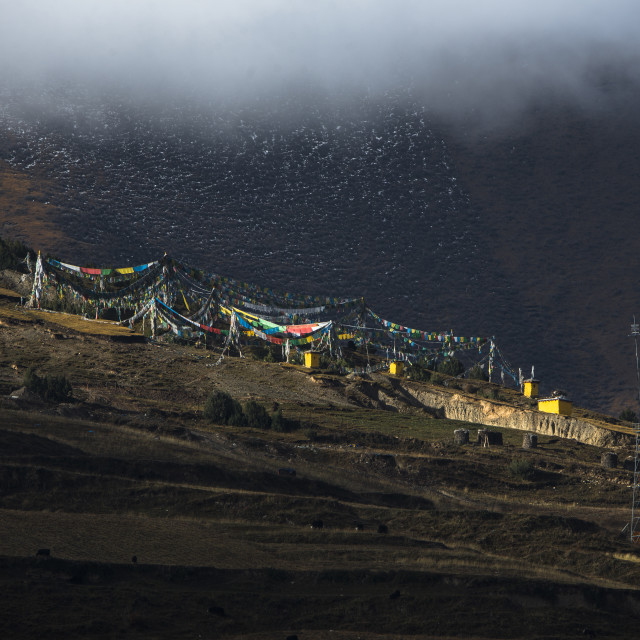 """Buddhist temple in Tibet plateau slope of the mountain."" stock image"