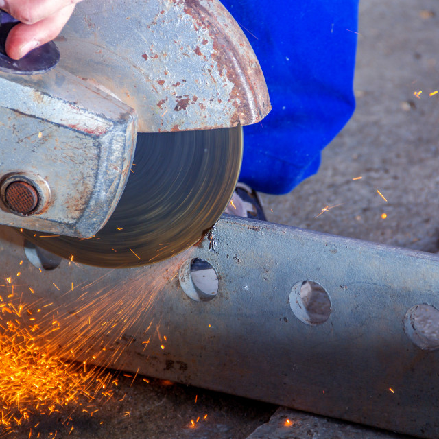 """""""Worker with angle grinder"""" stock image"""