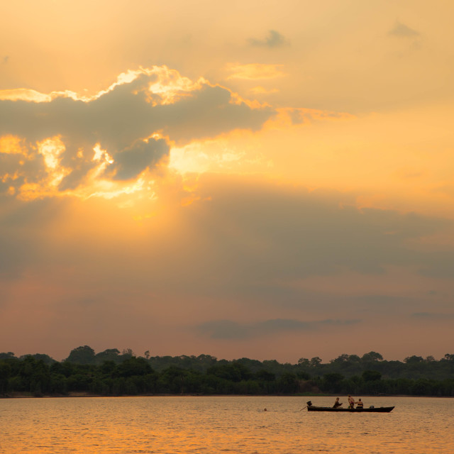 """Fishing at Sunset in the Amazon"" stock image"