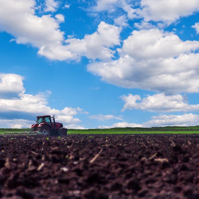 """Tractor preparing land"" stock image"