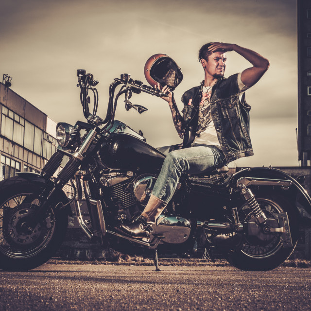 """""""Biker and his bobber style motorcycle on a city streets"""" stock image"""