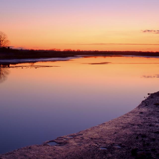 """Vivid River Sunset"" stock image"