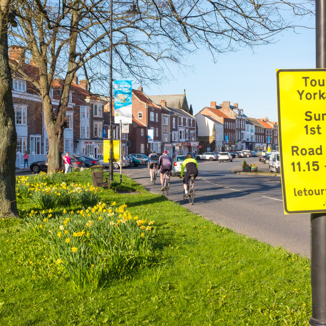 """Tour de Yorkshire 2016 cyclists ride past signage in the North Yorkshire town of Stokesley 4"" stock image"