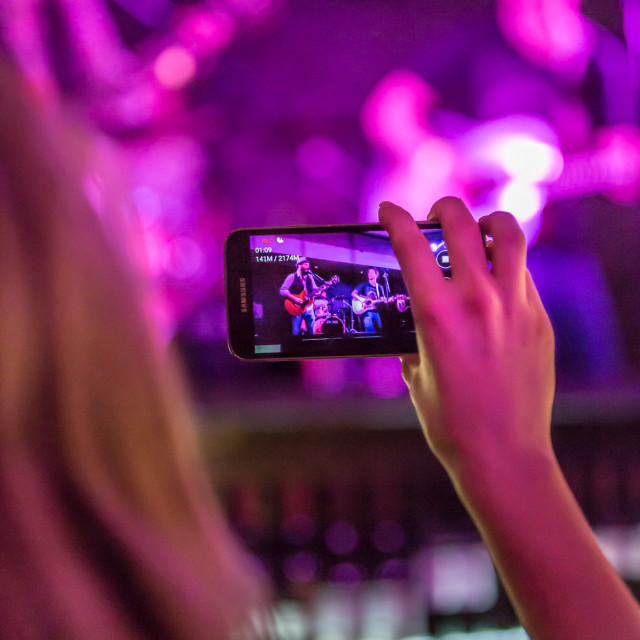 """Concert photographed with a mobile phone"" stock image"