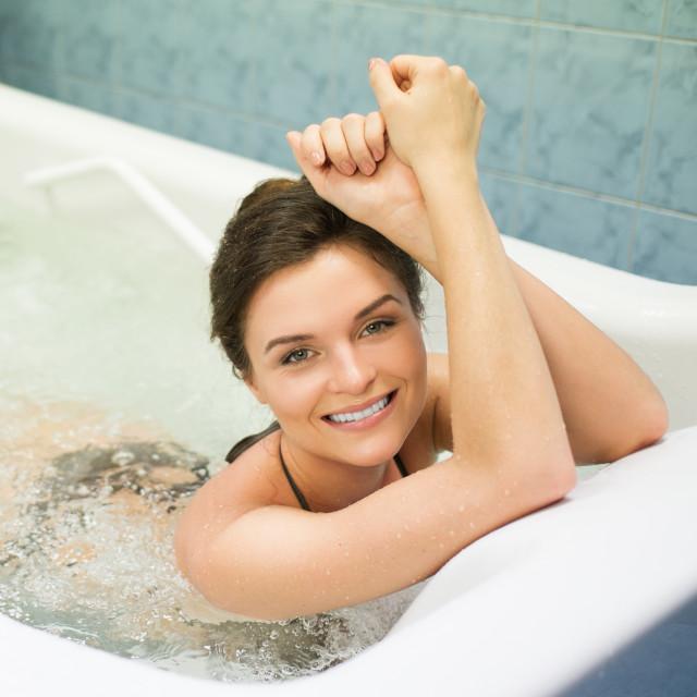 """Woman having procedure in a bathtub"" stock image"