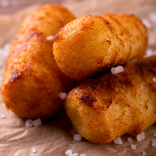 """Three fried potato croquettes with salt around"" stock image"