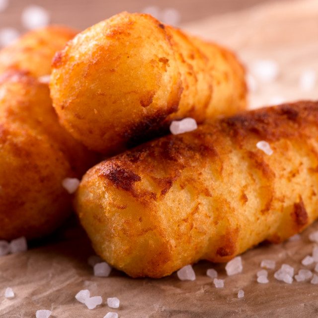 """Fried potato croquettes with salt on piece of paper"" stock image"