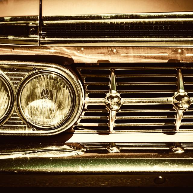 """Close-up of retro car facia with chrome grille"" stock image"