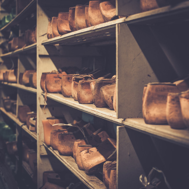 """""""Various of vintage wooden shoe lasts in a row on the old shelves."""" stock image"""