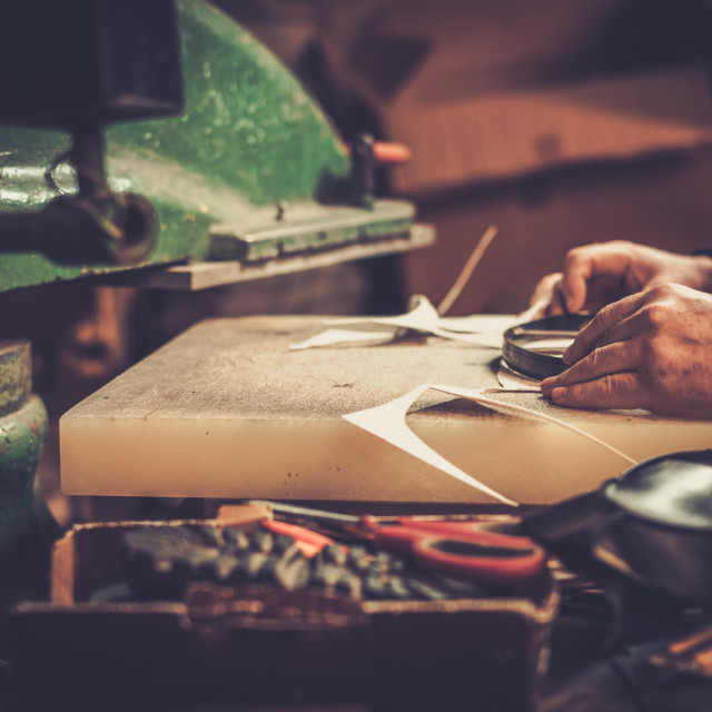 """""""Shoemaker performs shoes in the studio craft."""" stock image"""