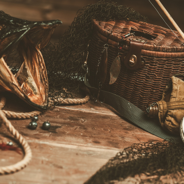 """Fishing tools and pike's head on a wooden table"" stock image"