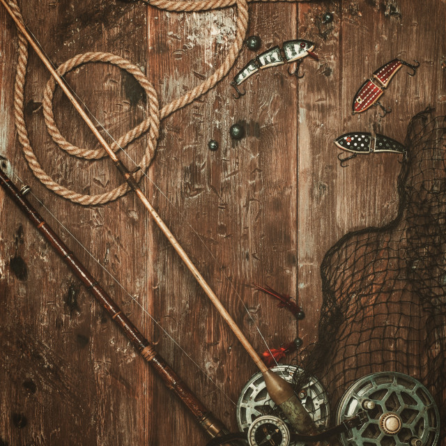 """Fishing tools on a wooden background"" stock image"