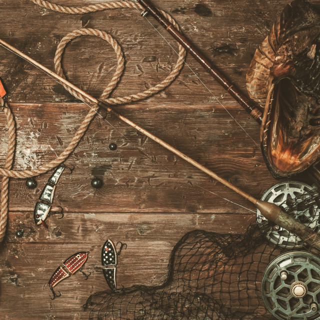 """""""Fishing tools and pike's head on a wooden table"""" stock image"""