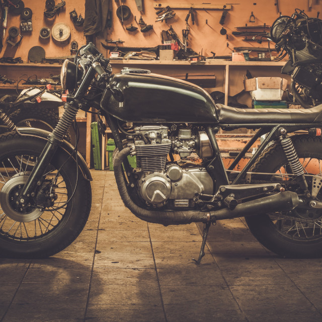 """""""Vintage style cafe-racer motorcycle in customs garage"""" stock image"""