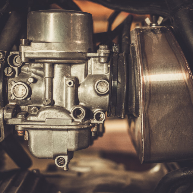 """Motorcycle carburetor with custom made air filter box"" stock image"