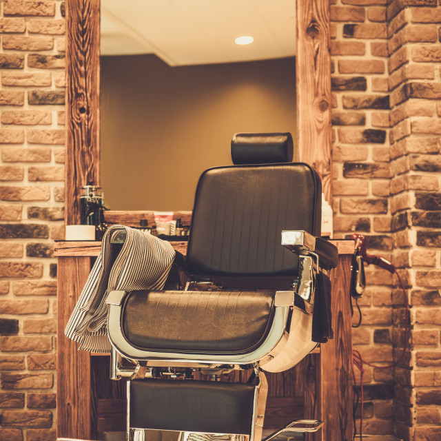 """Client's chair in barber shop"" stock image"