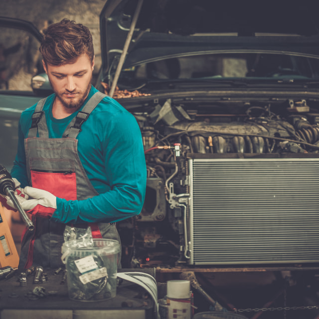 """""""Mechanic with pneumatic tool in a workshop"""" stock image"""