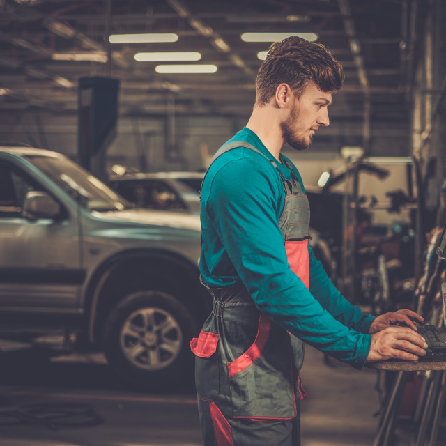 """""""Specialist near car diagnostic pc in a workshop"""" stock image"""