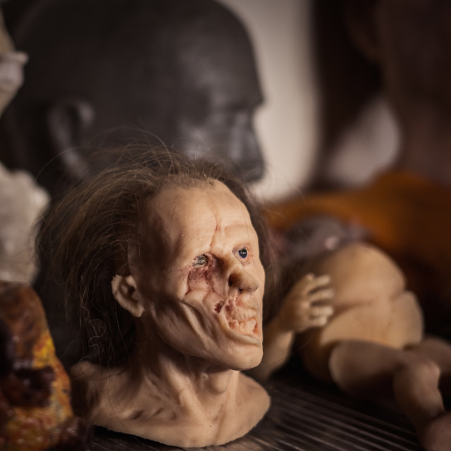 """""""Masks and dummies on a shelf in prosthetic special fx workshop"""" stock image"""