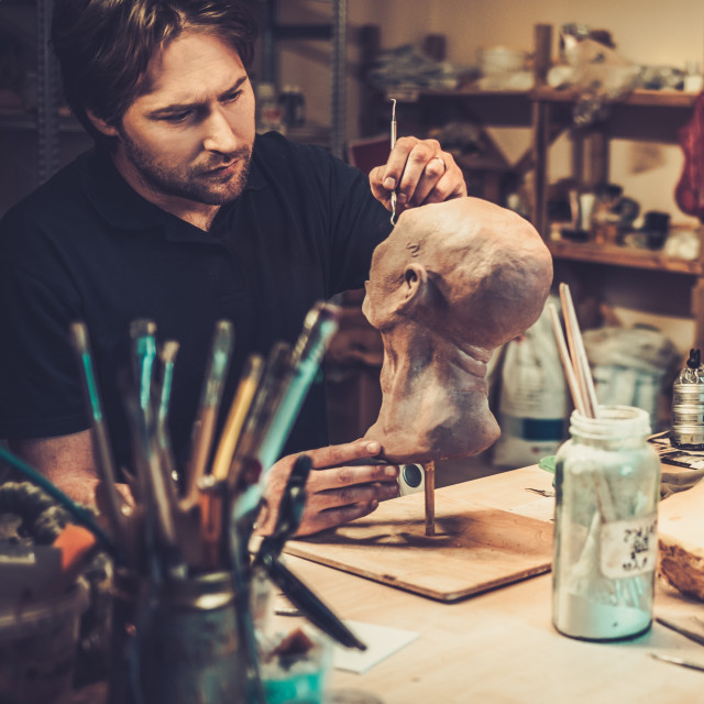 """""""Man working in a prosthetic special fx workshop"""" stock image"""
