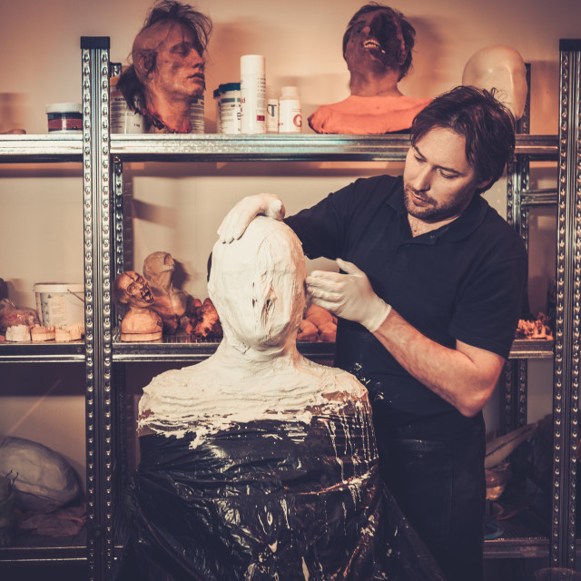 """""""Men during lifecasting process in a prosthetic special fx workshop"""" stock image"""