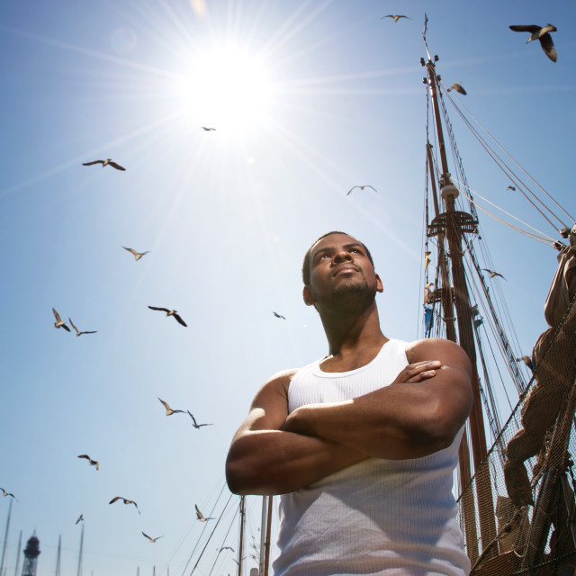 """""""Handsome afro-american man against boat's mast."""" stock image"""