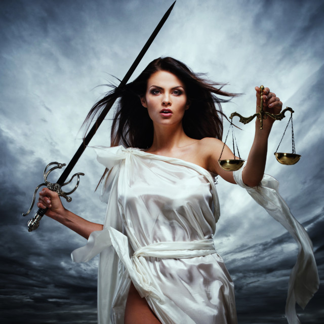 """""""Femida, Goddess of Justice, with scales and sword against dramatic stormy sky"""" stock image"""