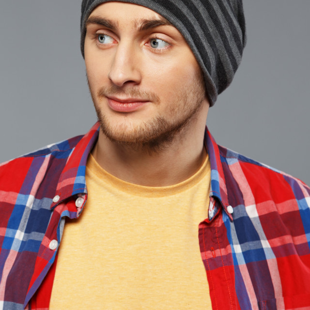 """Stylish young man in shirt and beanie hat"" stock image"