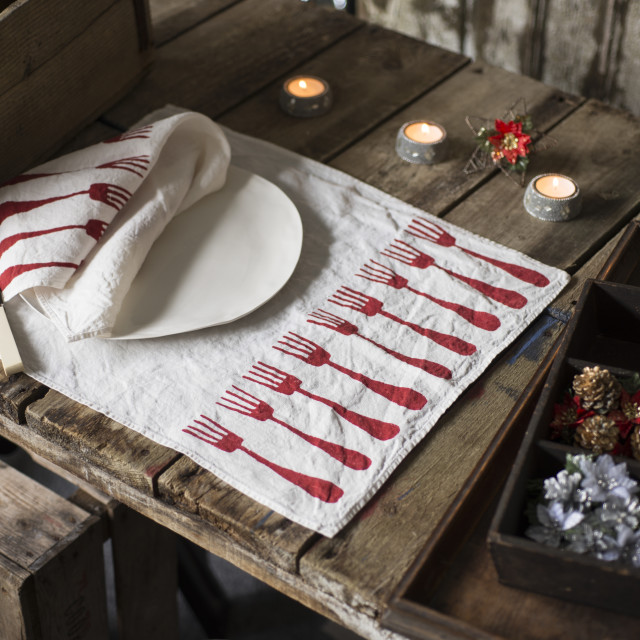 """""""Dinnerware with Matching Napkin and Placemat on Wooden Table"""" stock image"""