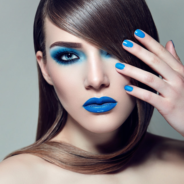 """Blue ink and a blue lipstick"" stock image"