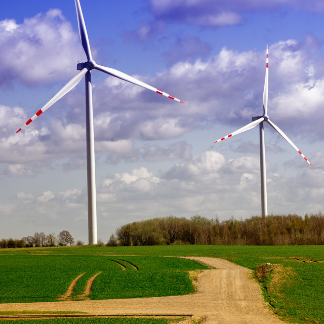 """""""Two wind turbines on a field"""" stock image"""