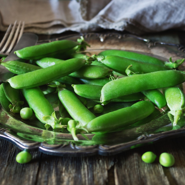 """Pods of fresh green peas"" stock image"