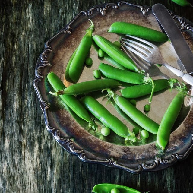 """Fresh green peas in a metal plate"" stock image"