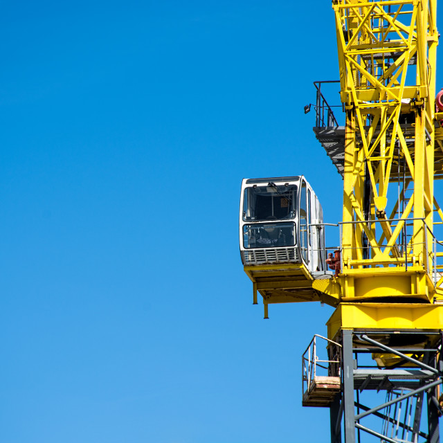 """Heavy construction site large yellow crane."" stock image"