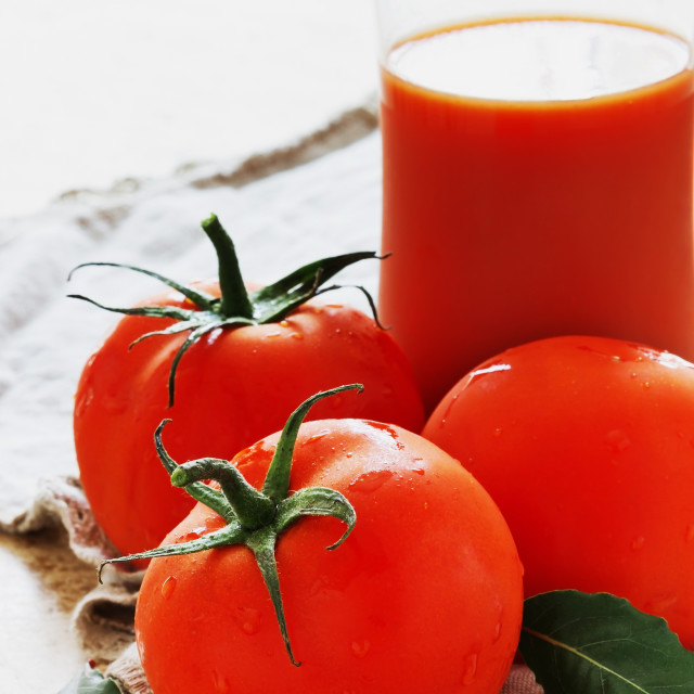 """Tomatoes and glass of tomato juice"" stock image"