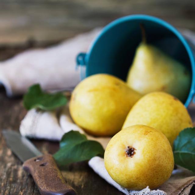 """Organic ripe pears in a small bucket"" stock image"