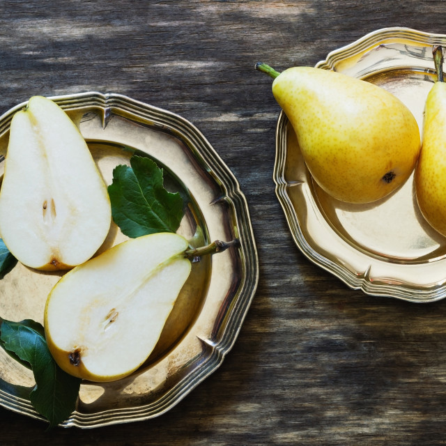 """""""Organic ripe pear in vintage plate"""" stock image"""