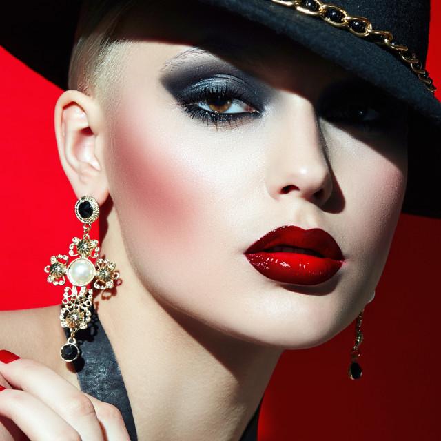 """Rock girl in a black hat."" stock image"
