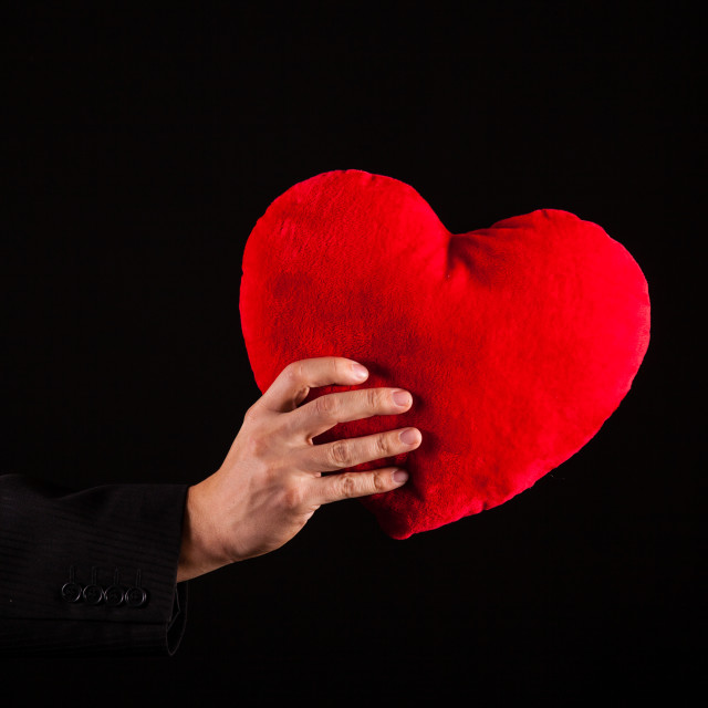 """man hold heart pillow"" stock image"
