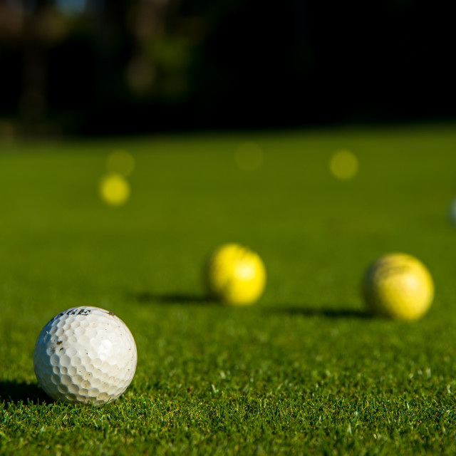 """Golf balls on the lawn"" stock image"