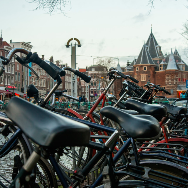 """Bikes at the canal near the square ""Nieuwmarkt""."" stock image"