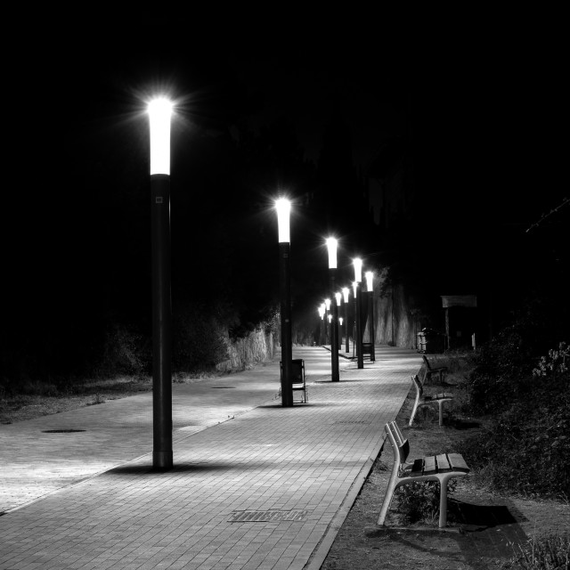 """""""Row of streetlights in a curved and cobbled Street"""" stock image"""