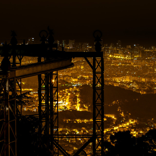 """Silhouette of the suspension railway and Barcelona panoramic nig"" stock image"